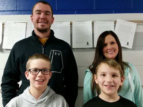 Thomas Jefferson's top two spelling challenge fundraisers, Nick R. and V. Hanz, are pictured with their teachers Mr. Haase and Ms. Johnston.