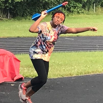 Alisha Hill, 12, practices throwing the turbo javelin