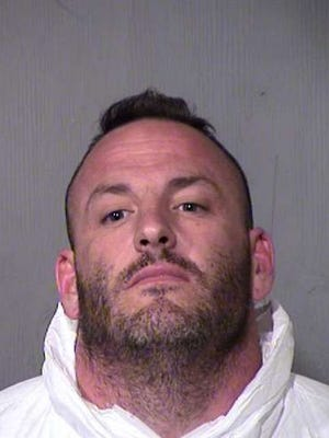 Christopher Wright, a former Phoenix police officer who killed his wife and a motorist near Loop 202 last summer, was sentenced Friday to two consecutive terms of natural life in prison.