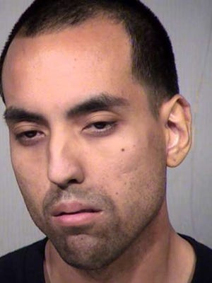 Jesus Andres Garcia  after leaving his 2-year-old son alone in a roach-infested apartment.