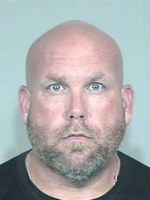 Cardinals General Manager Steve Keim surrendered himself to police Tuesday.