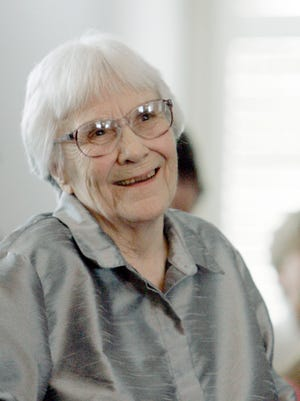 Author Harper Lee smiles during a ceremony in Montgomery in 2007.