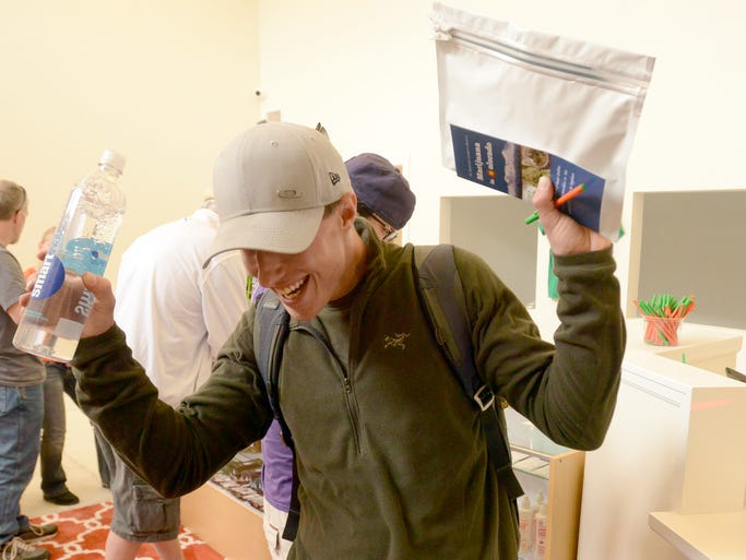 Lance Kosakewich of Fort Collins, shows his joy after making a purchase of recreational marijuana at Choice Organics in Fort Collins Wednesday April 9, 2014. Choice Organics is the first marijuana dispensary in Fort Collins to sell recreational marijuana.