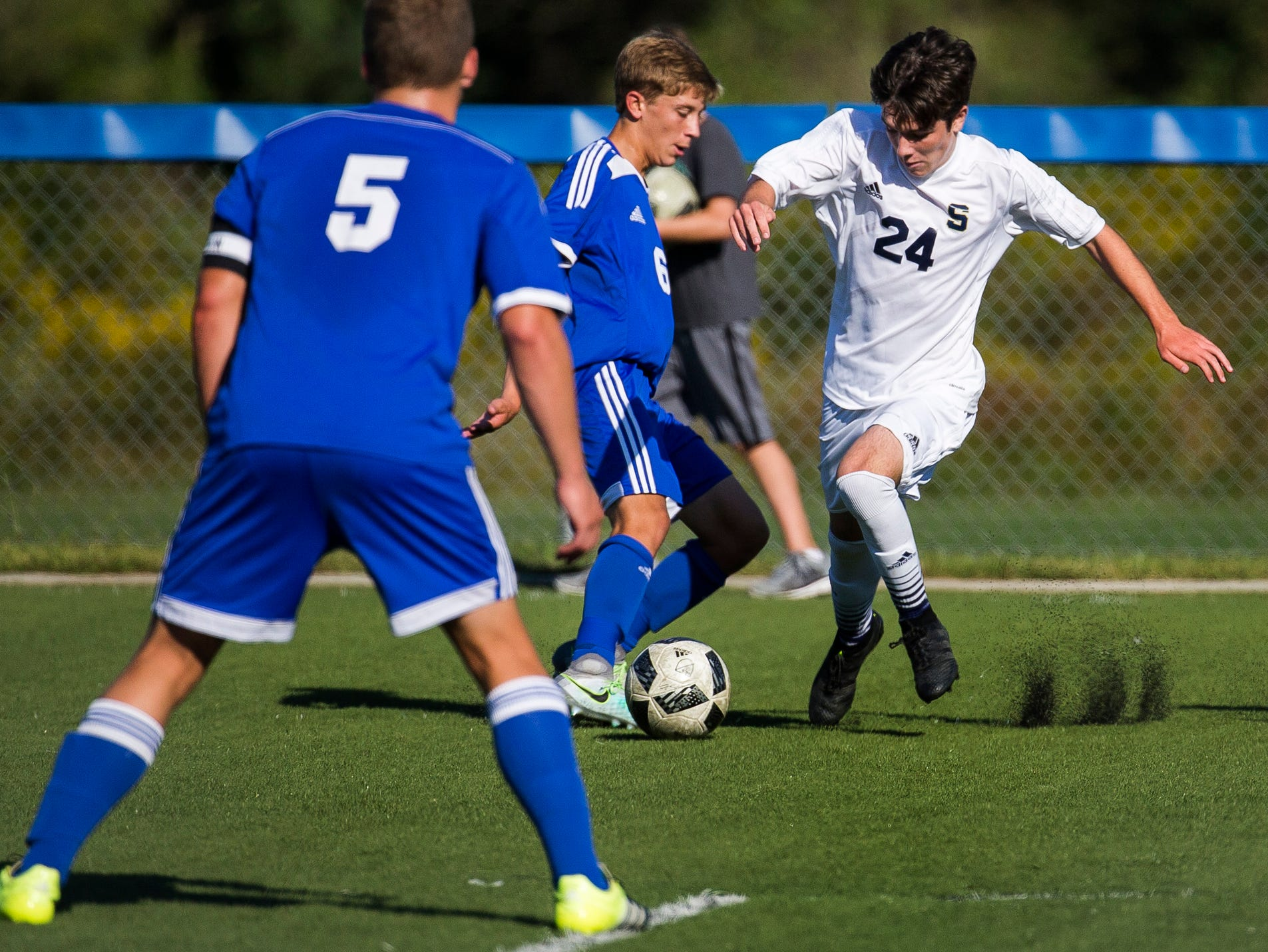 Salesianum's John Leonard (No. 24) tries to work past Wilmington Charter's Anthony Barbieri (No. 6) in the first half of Salesianum's 1-0 win over Wilmington Charter at the Hockessin Soccer Club in Hockessin on Thursday afternoon.