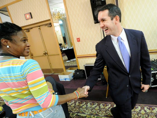 Charlene Lewis congratulates Eugene DePasquale on his victory on Tuesday, Nov. 6, 2012.