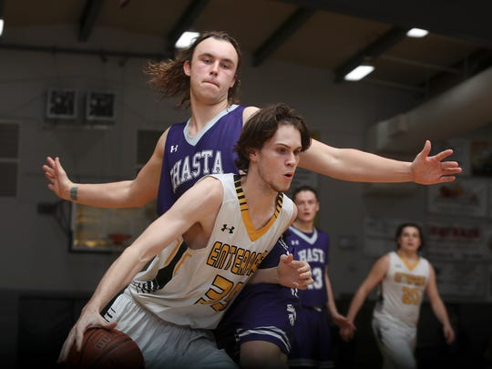Shasta High's Tanner Williams, left, guards Enterprise's Andrew Culmer in their game Friday.