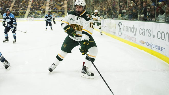Catatmounts forward Craig Puffer (17) looks to pass the puck during the men's hockey game between the Maine Black Bears and the Vermont Catamounts at Gutterson Fieldhouse on Friday night.