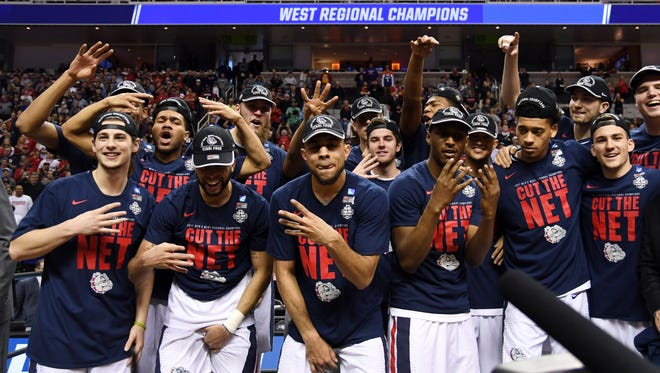 Gonzaga Bulldogs players celebrate after defeating the Xavier Musketeers in the West Regional finals of the 2017 NCAA Tournament.