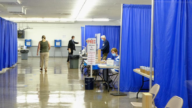 Poll workers are pictured at the city of Adrian's precincts at the Lenawee County Fair & Event Grounds Aug. 4 during the Michigan primary election.