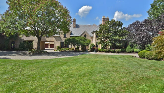 This six-bedroom European chateau sits at the end of a tree-lined drive on more than 3 acres in Harding.