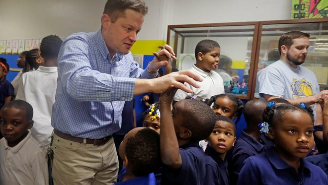 Principal Mike Turner greets students at St. Catherine Catholic School on Milwaukee's west side. Turner is in his second year at St. Catherine, one of nine schools in the new nonprofit Seton Catholic schools, a new initiative aimed at raising standards and achievement Archdiocese of Milwaukee elementary schools taking part in the Milwaukee Parental Choice voucher program.