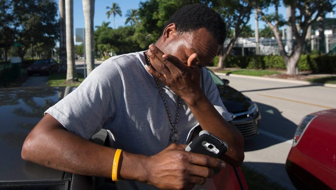 Jean Robert Archilles reacts, while speaking about the death of his son, Shawn Archilles,14,.  Archilles was killed in a mass shooting at Club Blu in Fort Myers.