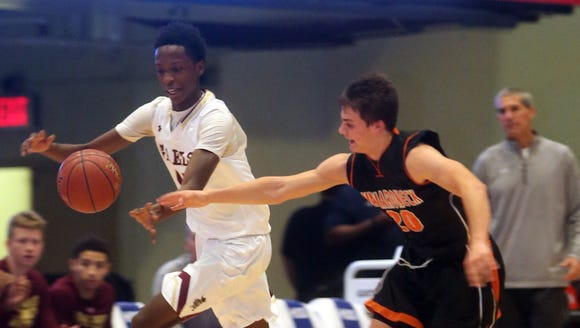 Souleymane Koureissi of Iona Prep chases a loose ball during the Slam Dunk championship game against Mamaroneck at the County Center on Dec. 29, 2016.