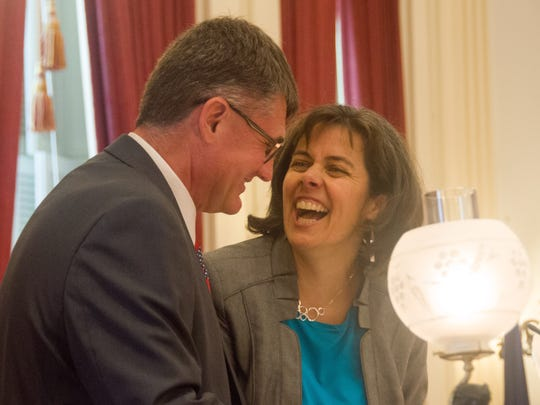 House Speaker Mitzi Johnson, D-South Hero, and House Minority Leader Don Turner, R-Milton, share a laugh at the podium in advance of a vote on whether to override Gov. Phil Scott's budget veto. The override failed.