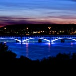 Blue lights light the historic 10th Street Bridge on weekend and special occasions. TRIBUNE PHOTO/LARRY BECKNER