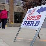 People enter to vote at the Sheboygan Falls Municipal Building Tuesday, April 1, 2014 in Sheboygan Falls.