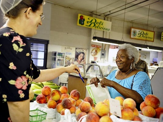 YDR; Annie Hall, 77, of Springettsbury Township, chats up farm stand employee Vashti Miller as Hall uses vouchers to purchase corn and peaches on a recent Friday.