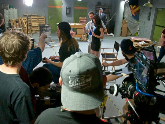 """The cast and crew work on the set of """"Postmarked,"""""""