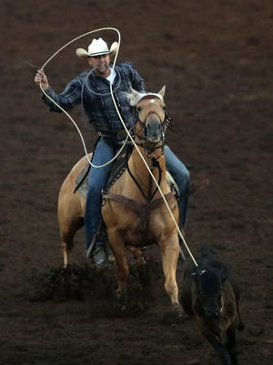 Jeremy Olson, of Cottage Grove, Wis., chases down a calf during the tie down roping event at the Mid-Western Rodeo Friday, June 30, 2017, at Hoffmann Memorial Park in Manawa, Wis.Danny Damiani/USA TODAY NETWORK-Wisconsin