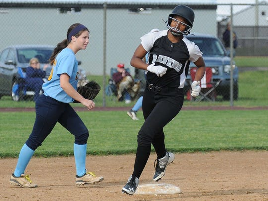 Sussex Tech's Jakayla Sample with a solo home run against Cape Henlopen during the match up on Monday. Megan Raymond Photo