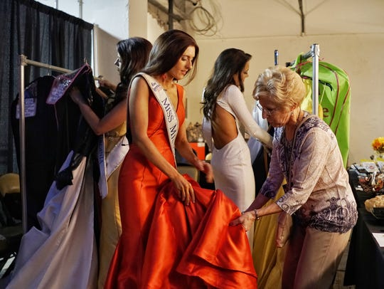 Erin O'Flaherty during a backstage dress fitting.