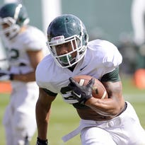 MSU's AJ Troup catches a touchdown pass last season against Jacksonville State. Troup, now a senior, is healthy and chasing a substantial role in the Spartan offense.