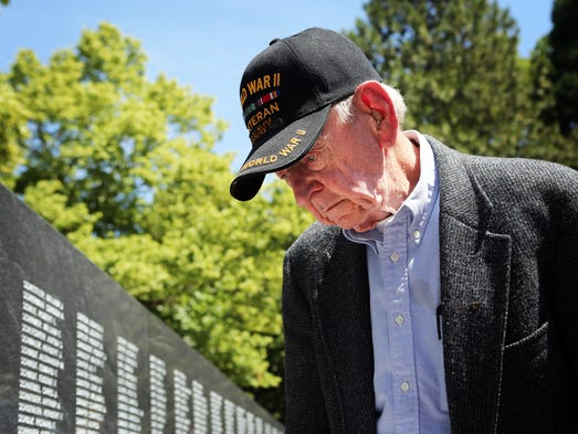 Joe Rolison, 90, a veteran of the Pacific theater, scours the wall for names. Hundreds of veterans and their supporters gather for the dedication of the Oregon World War II Memorial at Willson Park on the grounds of the State Capitol.