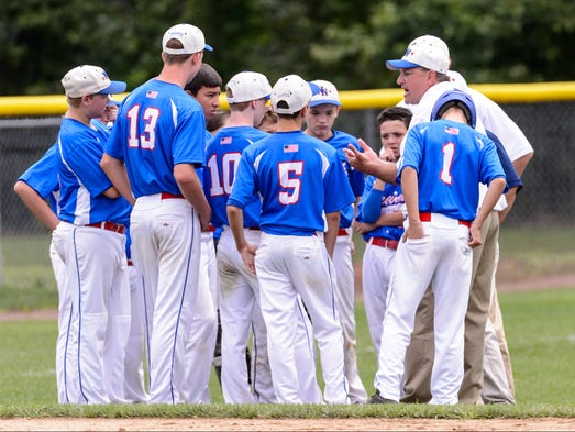 Newark National coach Joe Popitti talks to his players after being defeated by Taney Youth 8-4.