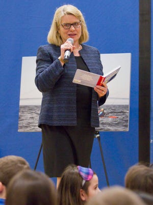 """Michigan Secretary of State Ruth Johnson reads from local author Denise Brennan's """"Little Michigan"""" to students at Hartland's Round Elementary School, one of two stops in the county Thursday."""