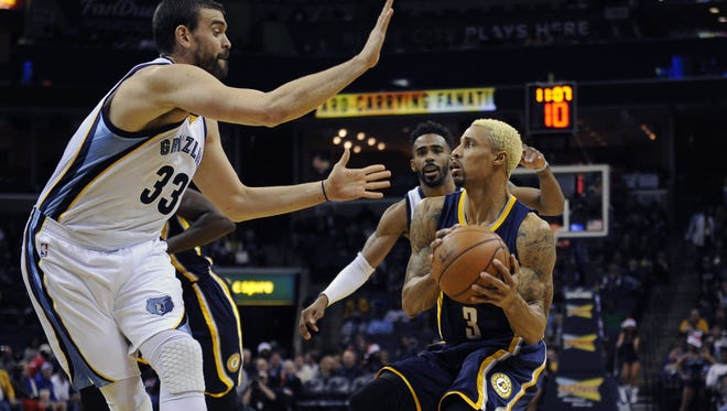 Pacers guard George Hill tries to work around the Grizzlies' Marc Gasol.