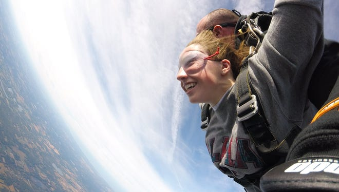 McKenna Haley, a freshman at Western Michigan University, makes her first tandem jump as part of Skydive Broncos.