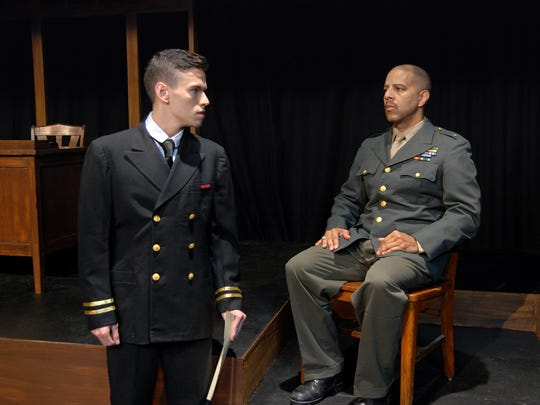 "Lt. Daniel Kaffee (Keith Martinez, left) questions Col. Nathan Jessup (Art Wallace) in Theatre Tallahassee's production of ""A Few Good Men."""