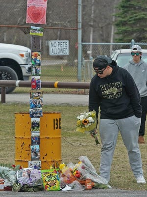 Mourners left flowers, candy and other mementos at the current basketball court on Berkley Commons. New courts will be built in honor of Devyn Crosby and Christian Couto, two Somerset Berkley grads who were killed in a March car crash.