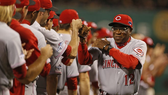 Former Reds manager Dusty Baker bumps fists with his players before the start of  their Wild Card play-off game against the Pittsburgh Pirates last October.