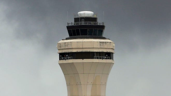 A file photo of the air traffic control tower at Miami International Airport.