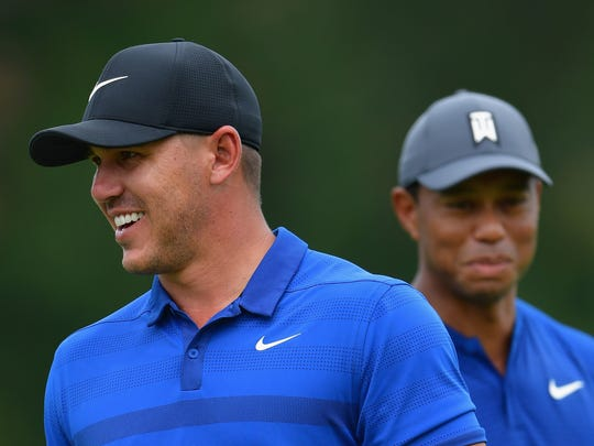 ST LOUIS, MO - AUGUST 08:  Brooks Koepka (L) and Tiger Woods (R) of the United States look on during a practice round prior to the 2018 PGA Championship at Bellerive Country Club on August 8, 2018 in St Louis, Missouri.  (Photo by Stuart Franklin/Getty Images) ORG XMIT: 775108891 ORIG FILE ID: 1013404788