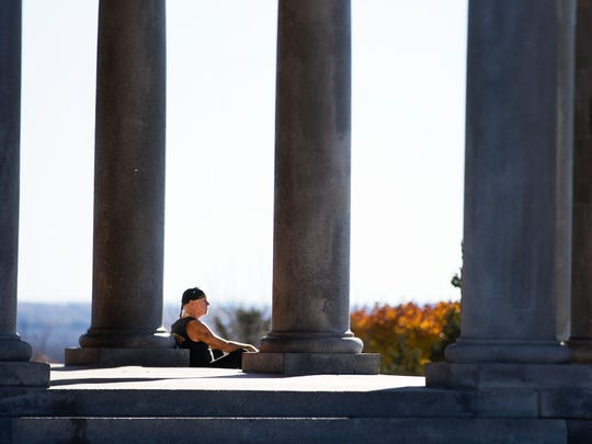 Joe Badilla of Rochester enjoys the view and record-setting temperature from the Cobbs Hill Reservoir Building on Nov. 4, 2015.