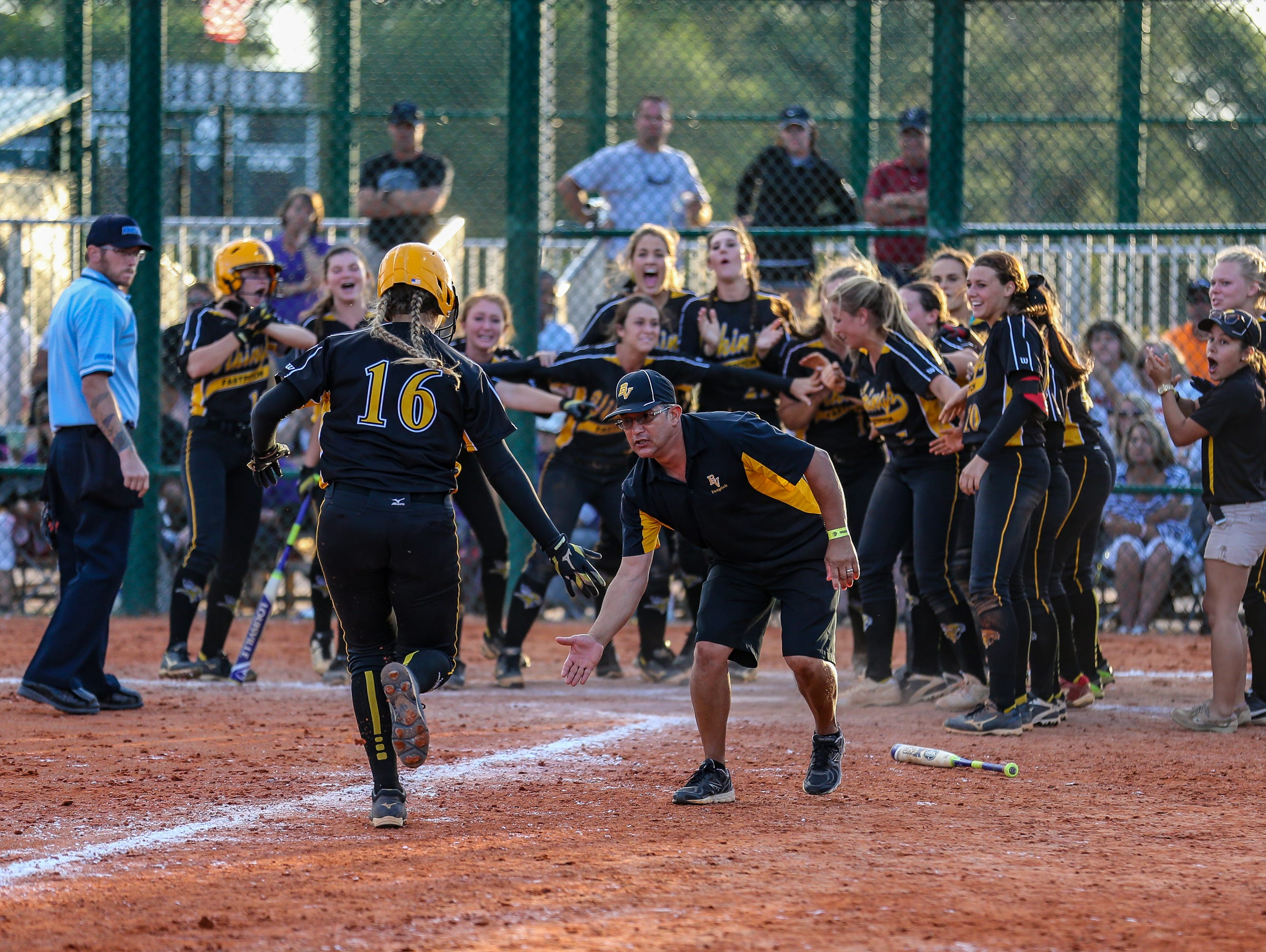 Sammie Massaro, No. 16, trots toward home plate and her waiting Bishop Verot teammates after her state-championship-clinching home run on Thursday.