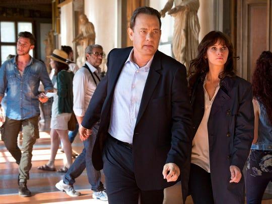 Tom Hanks as Langdon and Felicity Jones as Sienna in