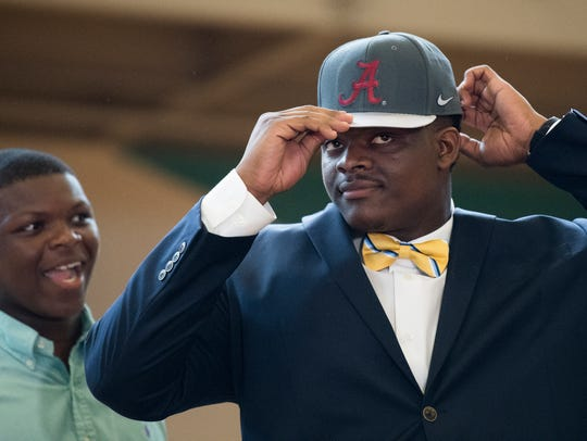 Stephon Wynn puts on a University of Alabama hat after