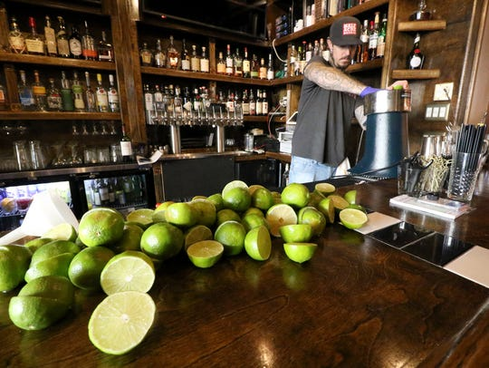 Jarod Packard squeezes fresh lime juice for craft cocktails