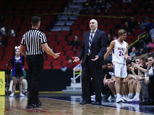 Waukee coach Justin Ohl argues a call with a referee