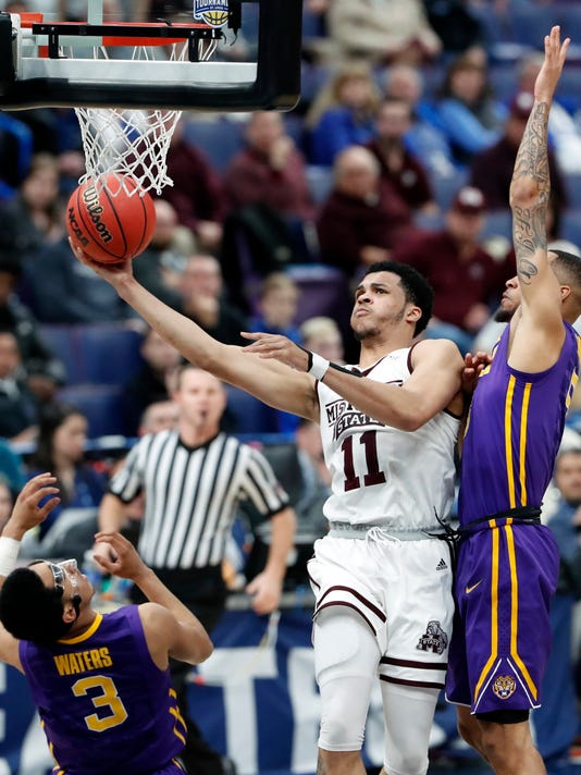 Mississippi State's Quinndary Weatherspoon, center, heads to the basket as LSU's Daryl Edwards, right, and Tremont Waters (3) defend during the first half in an NCAA college basketball game at the Southeastern Conference tournament Thursday, March 8, 2018, in St. Louis. (AP Photo/Jeff Roberson)