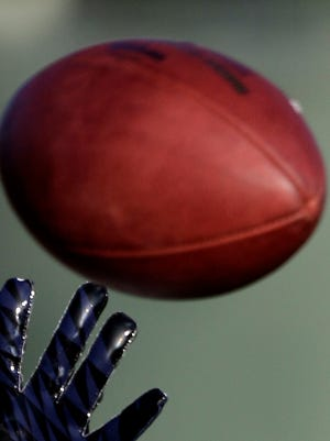 Player catches a football in this file photo.