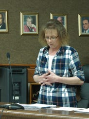 Bull Shoals Recorder/Treasurer Kim Williams reads the