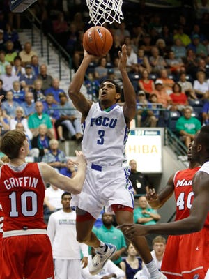 FGCU's Julian DeBose scores against Marist during the Gulf Coast Showcase at Germain Arena on Nov. 24, 2014, in Estero.