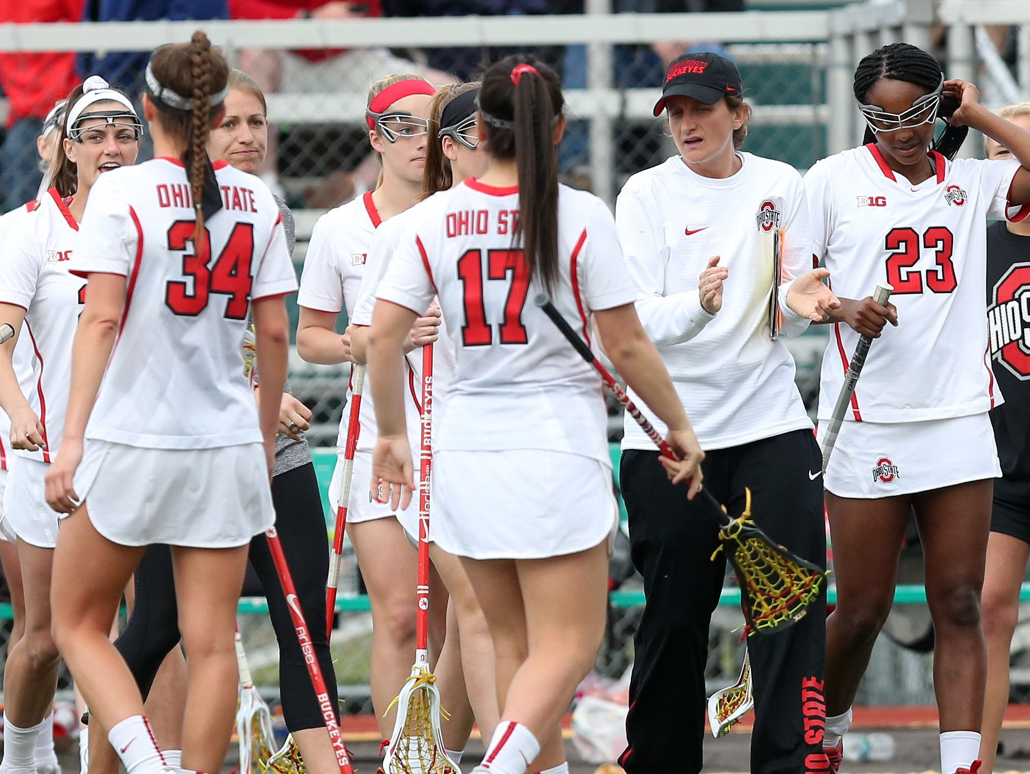 Ohio State girls lacrosse coach and Yorktown High School graduate Alexis Venechanos gets her team ready for game against Binghamton at Yorktown High School March 25, 2016. Ohio State won the game 10-5.