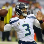 Quarterback Russell Wilson of the Seattle Seahawks completes a long pass against the Atlanta Falcons in the first half at the Georgia Dome in Atlanta, Sunday, Nov. 10, 2013. The Seahawks defeated the Falcons, 33-10. (Curtis Compton/Atlanta Journal-Constitution/MCT)