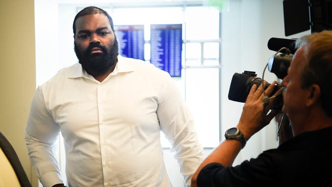 Former Titan Michael Oher (center) leaves the Justice A.A. Birch Building after his preliminary hearing for assaulting an Uber driver was continued to a later date in Judge Melissa Blackburn's courtroom Friday, July 21, 2017, in Nashville, Tenn.