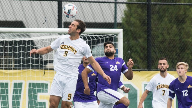 Vermont's Trevor Colazzo (9) leaps to head the ball during the men's soccer game between the Albany Great Danes and the Vermont Catamounts at Virtue Field on Saturday afternoon October 7, 2017 in Burlington.